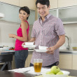 Happy Asian couple eating at home — ストック写真