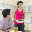 Happy Asian couple eating at home — Foto de Stock