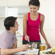 Happy Asian couple eating at home — Stok fotoğraf
