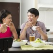 Happy Asian couple eating at home — Stok Fotoğraf #36810713
