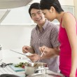 Stock Photo: Happy Asian couple together at home