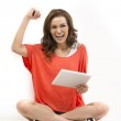 Excited Asian woman holding tablet & cheering. — Stock Photo