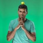 Happy Indian man balancing an Apple on his head — Stock Photo