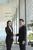 Chinese Business people shaking hands — Stock Photo