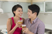 Happy Asian couple together at home — Stock Photo
