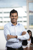 Indian Business man standing in an office — Stock Photo