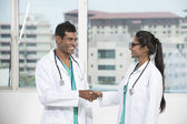 Two Indian doctors shaking hands — Stock Photo