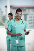 Male Indian doctor standing with his colleague — 图库照片