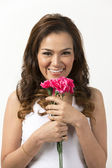 Happy Asian woman holding a flower — Stock Photo