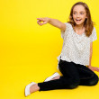Smiling young girl pointing away — Stock Photo #11781510