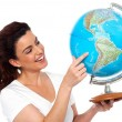 Woman holding globe in her hand — Stock Photo