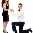 Guy on his knees proposing girl to marry — Stock Photo
