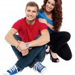 Attractive love couple sitting relaxed on floor — Stock Photo