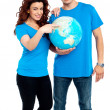 Couple posing for a picture with globe in hand — Stock Photo #12541171