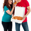 Stock Photo: Girl sharing pizzpiece with her boyfriend
