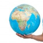 Cropped image of man holding globe — Stock Photo