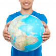 Stock Photo: Casual young guy presenting globe