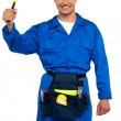 Smiling young repairman holding hammer — Stockfoto