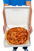 A picture of an open pizza box. — Stock Photo