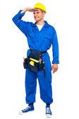 Repairman looking forward shielding hand — Stock Photo
