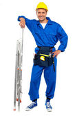 Industrial contractor resting hand on stepladder — Stock Photo