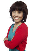 Side pose of smiling asian woman, arms crossed — Stock Photo