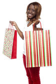Sale Sale Sale... Woman carrying shopping bags — Stock Photo