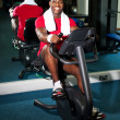 Young guy burning calories, pedaling fast — Stock fotografie