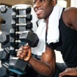 Royalty-Free Stock Photo: Young gym instructor toning his biceps