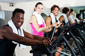 Energetic group working out together — Stock Photo