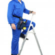 Construction worker climbing up the stepladder — Stock Photo