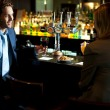 Attractive couple refreshing themselves at the bar — Stock Photo