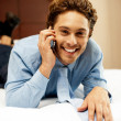 Relaxed young businessman communicating with his partner — Stock Photo