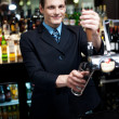 Royalty-Free Stock Photo: Bartender preparing to make cocktail
