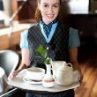 Profile shot of a cheerful female waitress — Stock Photo