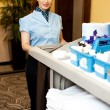 Charming female executive holding toiletries cart - Photo