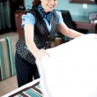 Stock Photo: Charming hotel hostess changing sheets