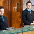 Stock Photo: Profile shot of attractive executives at reception
