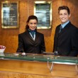 Trendy adorable couple at front office desk — Stock Photo #13537919