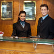 Trendy adorable couple at front office desk — Stock Photo