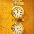 Stock Photo: World clock at reception wall