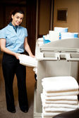 Housekeeping in charge pulling out the bath towel — Stock Photo