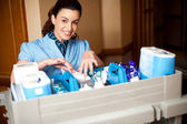 Working staff arranging toiletries in a wheel cart — Стоковое фото