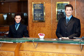 Front desk colleagues posing for a picture — Stock Photo