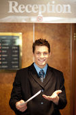 Young man holding an invoice — Stock Photo