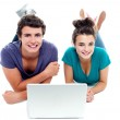 Teen friends enjoying video on laptop together — Stock Photo
