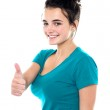 Gorgeous pretty girl showing thumbs up to you — Stock Photo