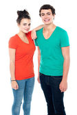 Adorable teenage couple in casuals — Stock Photo