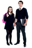 Full length portrait of students in uniform — Stock Photo
