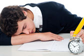 Teenager dozing off while writing his test — Stock Photo